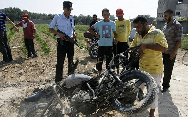 Palestinians inspect a motorcycle that was hit in a previous Israeli airstrike in the central Gaza Strip in 2012 (illustrative photo: Abed Rahim Khatib/Flash 90