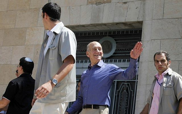 "Former Prime Minister Ehud Olmert leaves Jerusalem District Court in July 2012 after he was cleared of charges of double-billing on trips abroad in the ""Rishon Tours"" case, and cleared of charges of illegally taking money from American businessman Morris Talansky. (Photo credit: Flash90)"