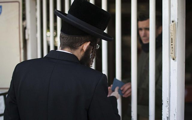 An ultra-Orthodox man enters the army recruiting office in Jerusalem (photo credit: Yonatan Sindel/Flash90)