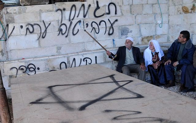 Illustrative photo of a price tag attack, a form of Jewish incitement against Arabs (Issam Rimawi/Flash90)