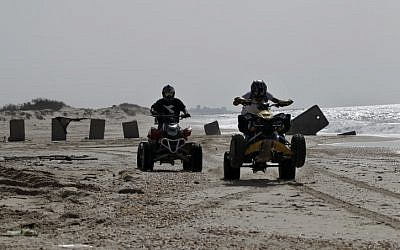 Israeli ATV riders on the beach (illustrative photo credit:  Tsafrir Abayov/Flash90)