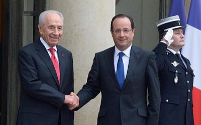 French President Francois Hollande, right, welcomes Israeli President Shimon Peres at the Elysee Palace in Paris on March 8. (photo credit: Moshe Milner/ GPO/Flash90)