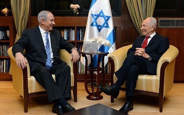 President Shimon Peres meets with Prime Minister Benjamin Netanyahu on March 16, 2013. Netanyahu informed the president he had formed a coalition. (Photo credit: Kobi Gideon / GPO/FLASH90)