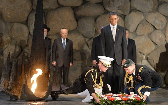 Illustrative: US President Barack Obama pays his respects in the Hall of Remembrance as marines lay a wreath on his behalf during a visit to the Yad Vashem Holocaust Museum on March 22, 2013 (photo credit: Amos Ben Gershom/GPO/Flash90)