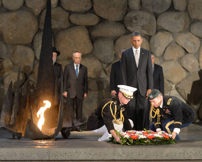 US President Barack Obama pays his respects in the Hall of Remembrance as marines lay a wreath on his behalf during a visit to the Yad Vashem Holocaust Museum on March 22, 2013 (photo credit: Amos Ben Gershom/GPO/Flash90)