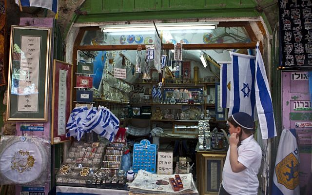 A Jewish child stands at the entrance to a shop in Jerusalem's Old City on March 27, 2013, during the Passover holiday (photo credit: Sliman Khader/Flash90)