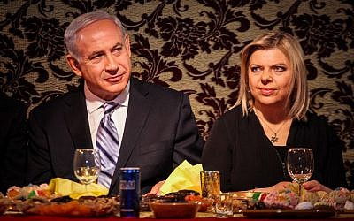 Prime Minister Benjamin Netanyahu and his wife Sara celebrate the Mimouna in Or Akiva. (photo credit: Avishag Shaar Yashuv/Flash90)