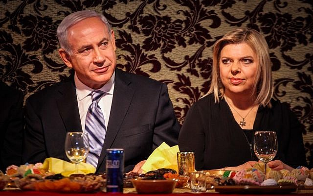 Prime Minister Benjamin Netanyahu and his wife Sara celebrate the Mimouna in Or Yehuda in April 2013. (photo credit: Avishag Shaar Yashuv/Flash90)
