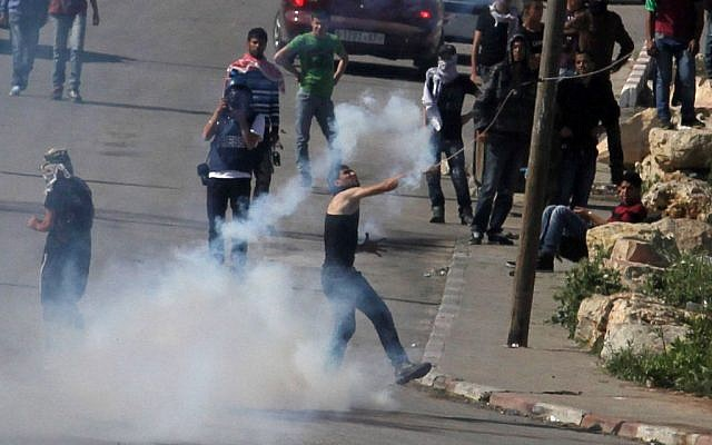 Palestinians clashing with troops near the Ofer military prison  in April. (photo credit: issam Rimawi/Flash90)