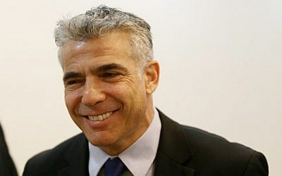 Finance minister Yair Lapid. (photo credit: Alex Kolomoisky/Flash90)