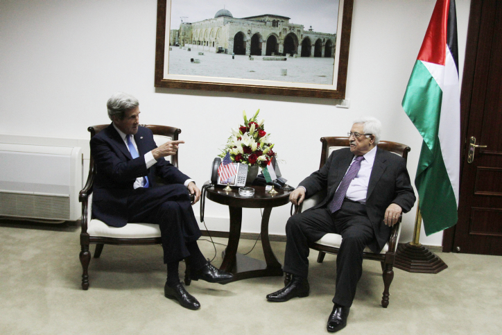 US Secretary of State John Kerry (left) seen with Palestinian Authority President Mahmoud Abbas in the West Bank city of Ramallah, April 7, 2013. (photo credit: Issam Rimawi/Flash90)