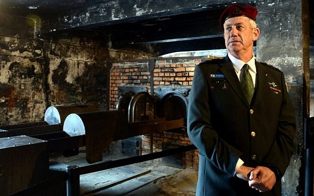 IDF Chief of Staff Benny Gantz visiting the crematorium at the Auschwitz death camp in Poland, as he takes part in the 'March of the Living' on the eve of Holocaust Remembrance Day, on April 7, 2013. (photo credit: Yossi Zeliger/Flash90)