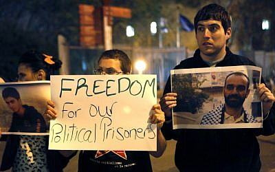 Palestinians demonstrate in support of hunger strikers in Israeli prisons, April 9, 2013. (photo credit: Sliman Khader/Flash90)