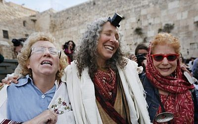 Women of the Women of the Wall organization wear prayer shawls as they pray at the Western Wall  in Jerusalem, April 11, 2013 (photo credit: Miriam Alster/Flash90)