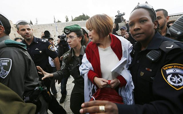 Women of the Wall director Lesley Sachs is detained by police for wearing a prayer shawl at the Western Wall on April 11 (photo credit: Miriam Alster/Flash90)