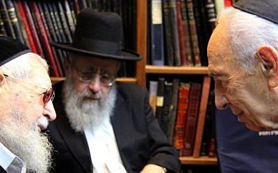 President Shimon Peres, right, on Sunday comforts Shas spiritual leader Rabbi Ovadia Yosef, left, upon the death of his son Yaakov (Photo credit: Yosef Avi Yair Engel/GPO/Flash90)
