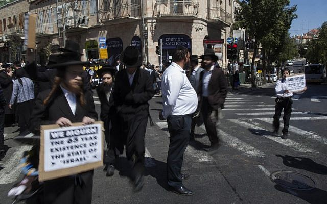 Anti-Zionist men marching during the two-minute siren on Monday morning. (photo credit: Yonatan Sindel/Flash90)