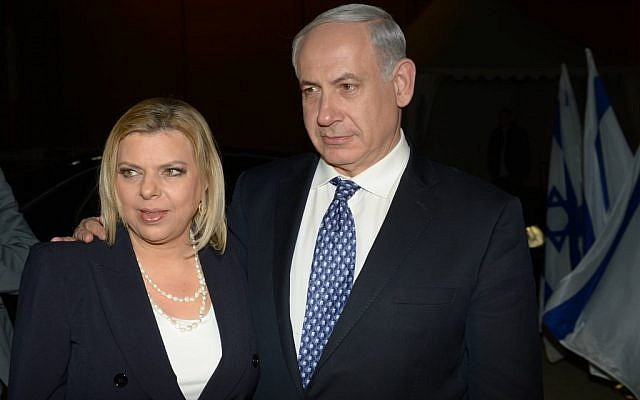 Prime Minister Benjamin Netanyahu and his wife Sarah board a plane at Ben Gurion Airport, outside of Tel Aviv, bound for London, April 16, 2013. (photo credit: Amos Ben Gershom/GPO/Flash90)