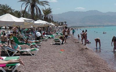 Local and foreign tourists sunbathe in the resort city of Eilat. (Illustrative photo credit: Flash90)