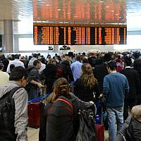 Illustrative: Thousands of Israelis stand in line at the departure terrminal at Ben Gurion International airport on April 20, 2013. Israeli airlines employees called a strike for Sunday to protest against a government proposal to finalize a deregulation plan with European carriers which they say would result in widespread layoffs (photo credit: Yossi Zaliger/Flash90)