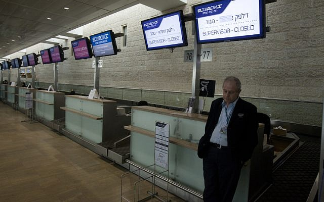 An airline worker gets some shut-eye at the departure hall of Israel's Ben Gurion International Airport on Sunday, April 21 (photo credit: Flash90)