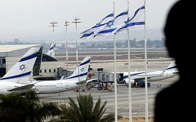 A boy looks down at El Al jets parked on the tarmac of Ben Gurion International Airport  (photo credit: Flash90)