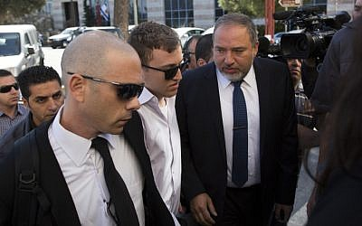 Former Foreign Minister Avigdor Liberman makes his way to Jerusalem Magistrate's Court on April 25 (photo credit: Yonatan Sindel/Flash90)