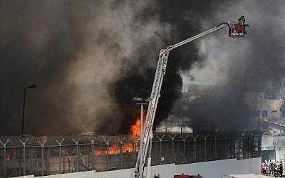Firefighters battle a fire which broke out at the Maasiyahu Prison prison facility, near Tel Aviv, on Sunday, April 28 (photo credit: Yossi Zeliger/Flash90)