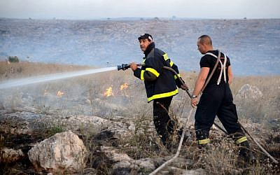 Israeli firefighters were working overtime this Lag B'Omer (photo credit: Yossi Zeliger/Flash90)