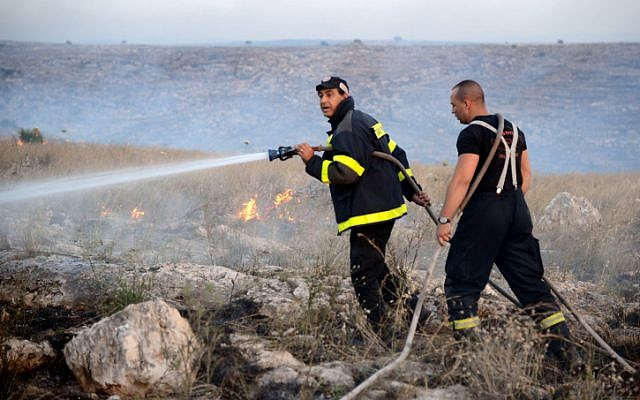 Illustrative photo of Israeli firefighters (photo credit: Yossi Zeliger/Flash90)