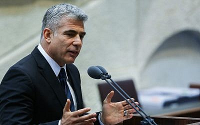 Yair Lapid speaks from the Knesset podium. (photo credit: Yonatan Sindel/Flash90)