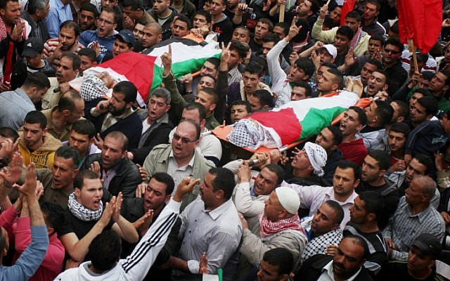 Palestinians carry the bodies of Amer Nassar, 17, and Naji Belbisi, 18, during their funeral in the West Bank village of Anabta near Tulkarem, April 4, 2013. (photo credit: Issam Rimawi/Flash90)