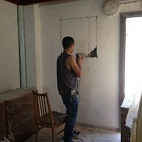 The handyman from next door, putting in a window (Courtesy Shira Wise)