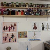 Spools of thread and etchings on Wise's studio walls (photo credit: Jessica Steinberg/Times of Israel)