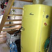 The yellow refrigerator in its staircase niche (photo credit: Jessica Steinberg/Times of Israel)