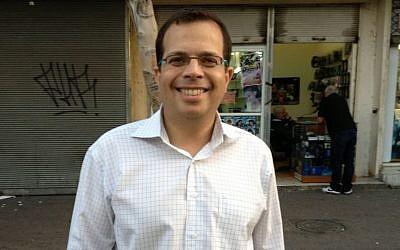 Liad Shoham, attorney and thriller writer, hanging around Tel Aviv's Shuchnat HaTivka (photo credit: Jessica Steinberg/Times of Israel)