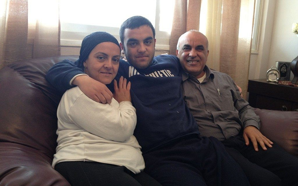 Shula, Elior and Aharon Babian at home in Beit Shemesh (photo credit: Jessica Steinberg/Times of Israel)