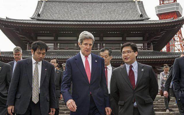 US Secretary of State John Kerry, center, tours the Zojoji Buddhist temple in Tokyo Sunday, April 14, 2013. (photo credit: AP/Paul J. Richards)