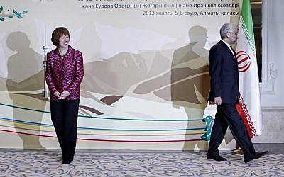 EU foreign policy chief Catherine Ashton, left, smiles, as Secretary of Iran's Supreme National Security Council Saeed Jalili walks away, after a photo op at the start of high-level talks between world powers and Iranian officials in Almaty, Kazakhstan, on Friday. (photo credit: AP/Shamil Zhumatov, Pool)