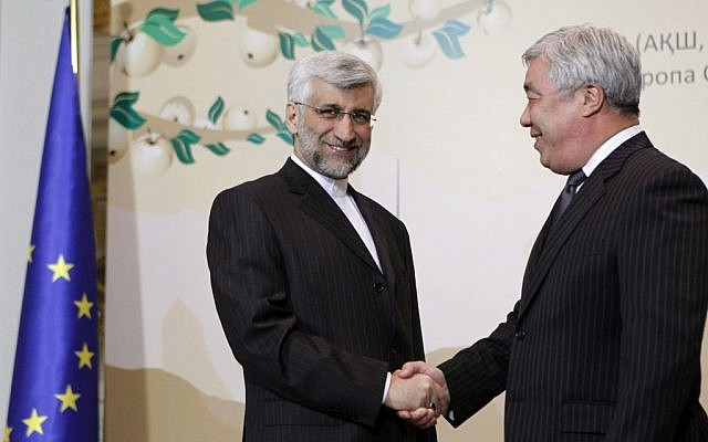 Saeed Jalili, secretary of Iran's Supreme National Security Council, left, shakes hands with Kazakhstan's Foreign Minister Yerlan Idrisov in Almaty on Friday. (photo credit: AP/Shamil Zhumatov, Pool)