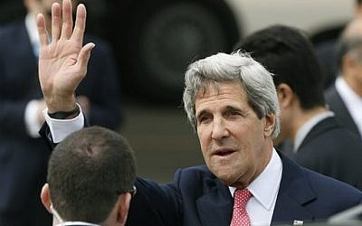 US Secretary of Sate John Kerry waves to the media upon arriving at Tokyo, Sunday, April 14, 2013 (photo credit: AP Photo/Shizuo Kambayashi)