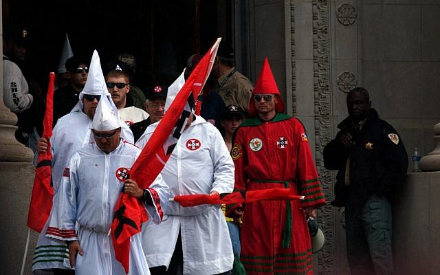 Klansmen exiting the Shelby County Courthouse in Memphis, Tennessee, moments before their rally, March 30, 2013. (photo credit: JTA/Blake Billings)