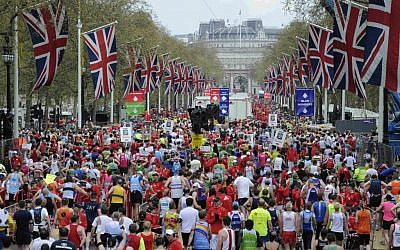 Competitors make their way from the finish area at the London Marathon in 2010. (photo credit: Tom Hevezi/AP)