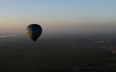 A hot-air balloon flies over the city of Luxor, Egypt, 2012. (photo credit: AP/Nariman El-Mofty)