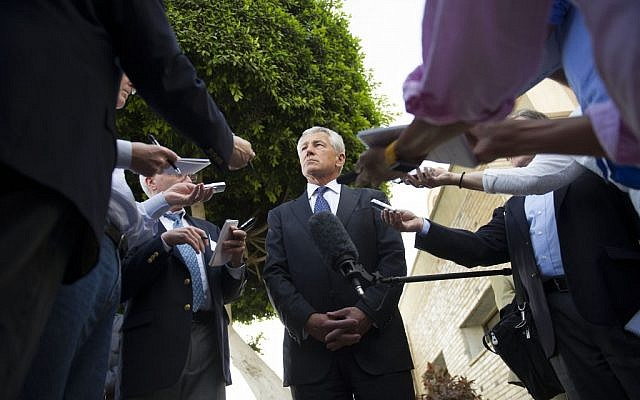 US Secretary of Defense Chuck Hagel speaks with reporters after meeting Egyptian President Mohammed Morsi and Egypt's Defense Minister in Cairo, on Wednesday, April 24, 2013. (photo credit: AP/Jim Watson)