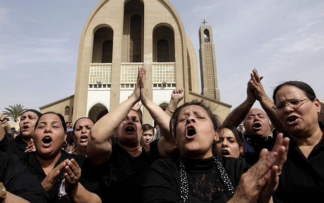 Egyptian Christians chant anti-Muslim Brotherhood slogans following a funeral service at the Saint Mark Coptic cathedral in Cairo, Egypt, Sunday, April 7, 2013. (photo credit: AP/Amr Nabil)