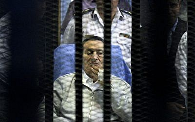 Egypt's deposed president Hosni Mubarak attends a hearing session in his retrial on appeal in Cairo, Egypt, Monday, April 15, 2013 (photo credit: AP/Ahmed Gomaa)