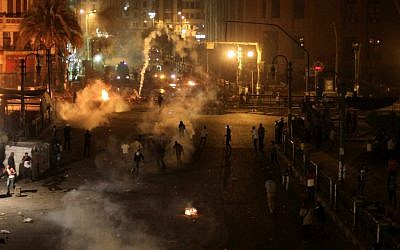 Tear gas fills downtown Cairo as protesters clash with security forces, Saturday, April 6, 2013. (photo credit: AP/Mostafa Elshemy)