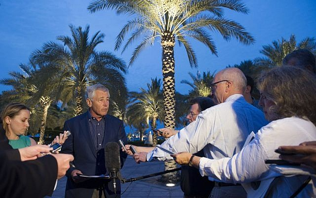 Chuck Hagel speaking with reporters after reading a statement on chemical weapon use in Syria during a press conference in Abu Dhabi on Thursday. (photo credit: AP/Jim Watson, Pool)