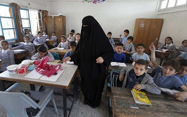 Palestinian children attend a class at the UNRWA elementary school in the Shati refugee camp in Gaza City, in April 2013 (Illustrative photo credit: AP/Hatem Moussa)